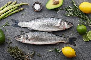 Fresh raw seabass and ingredients