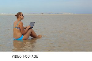Woman using laptop sitting