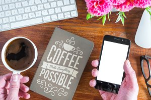 smartphone notebook and coffee