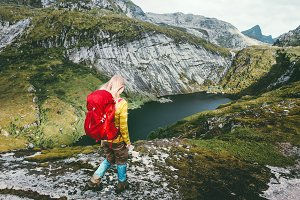 Woman hiker with backpack trekking