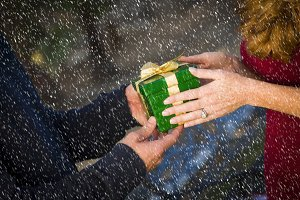 Man & Woman Hands Exchanging Gift