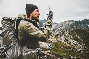 Man traveler using smartphone gps