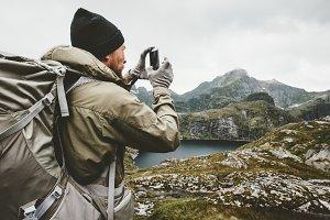Man traveler checking smartphone gps