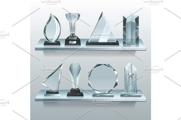 Collections Of Transparent Trophies Awards And Winner Cups On Shelf Of Glass