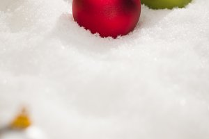 Colored Christmas Ornaments on Snow