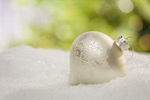 White Christmas Ornament on Snow
