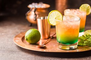 Orange cocktail decorated with lime