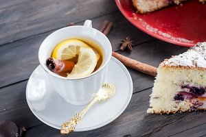 tea with lemon and a fruit pie