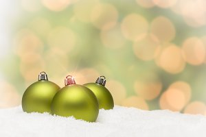 Green Christmas Ornaments on Snow