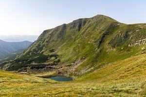 A high mountain hill. Mountain cliff