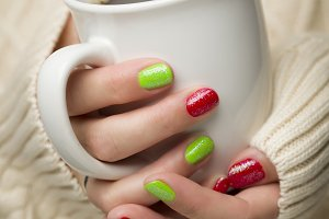 Woman with Red and Green Nail Polish