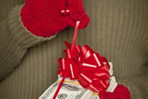 Woman in Red Mittens Holding Money
