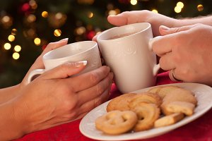 Couple Sharing Cocoa & Cookies