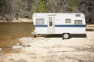 Classic Camper Trailer Near River