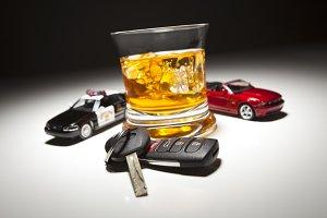 Police, Sports Car & Keys Near Drink