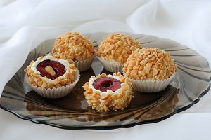 Cheese balls with cherries in peanut