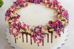 Festive cake with cream flowers hydrangea on a light background