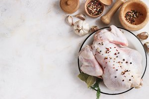 chicken with seasonings on a light background