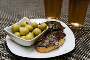 Spanish tapa set with olives and chorizo
