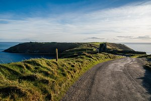 Scenic view of peninsula of Kinsale with green hills at sunset