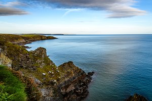 Scenic view of cliffs in Irish coast at sunset.