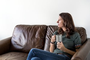 Thoughtful woman drinking tea