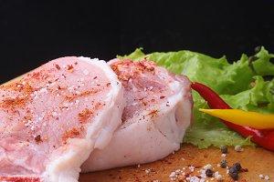 Raw steak, chop on cutting board.