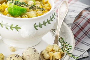 Thick vegetable soup puree with Brussels sprouts, croutons, pumpkin seeds