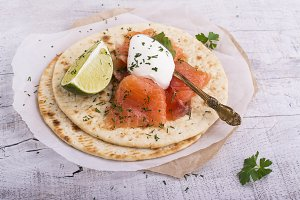 stack of pancakes with salted salmon on a plate