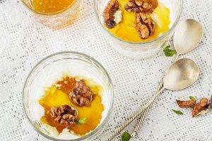 Yogurt dessert with honey and nuts