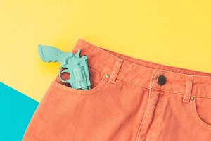 a plastic gun in the pocket