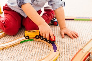 Boy plays with train