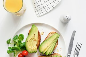 Avocado toasts and orange juice