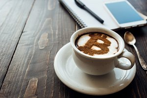 Cup of coffee with bitcoin symbol on