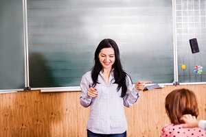 Smiling teacher explains