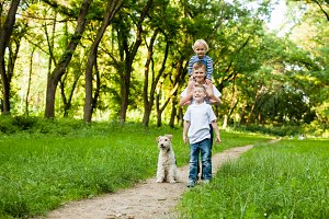 Kids with fox terrier dog