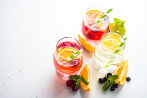 White, pink and red sangria with fruit