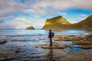 Hiker at Haukland beach on Lofoten islands, Norway