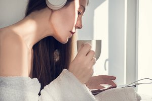 Cute, young woman listening to music