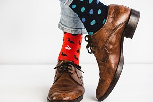 Men's legs in bright, colorful socks