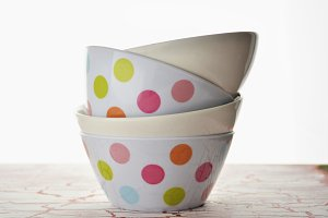 empty plastic bowls with colored spo