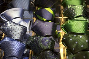 blue and green ties on exhibitor
