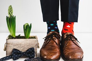 Groom, funny socks, rings, flower