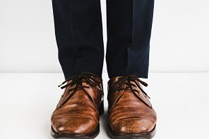 Stylish shoes and blue trousers