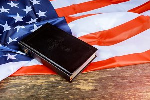 Holy Bible and the US. flag