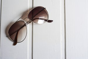 Sunglasses with brown glass on white