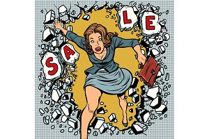A woman runs for sales, breaking the wall