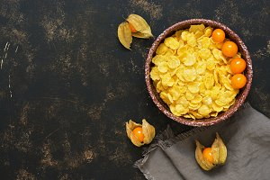 Corn flakes in a bowl with Physalis