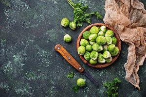 Brussels sprouts on green concrete background