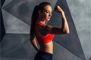 Fit women posing and showing bicep Sport fitness